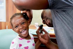 Audiologist, Alfred Mwamba, examines Chimya (4) at Beit CURE Hospital, in Zambia