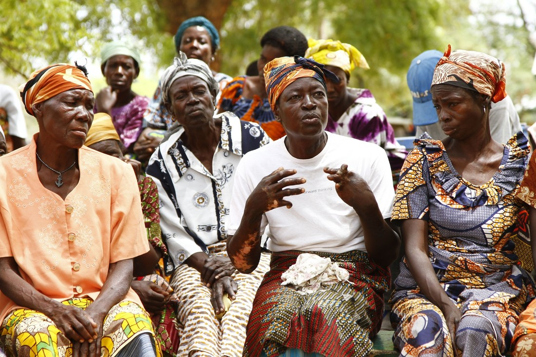 Women speaking at a self-help group for people with disabilities in Ghana