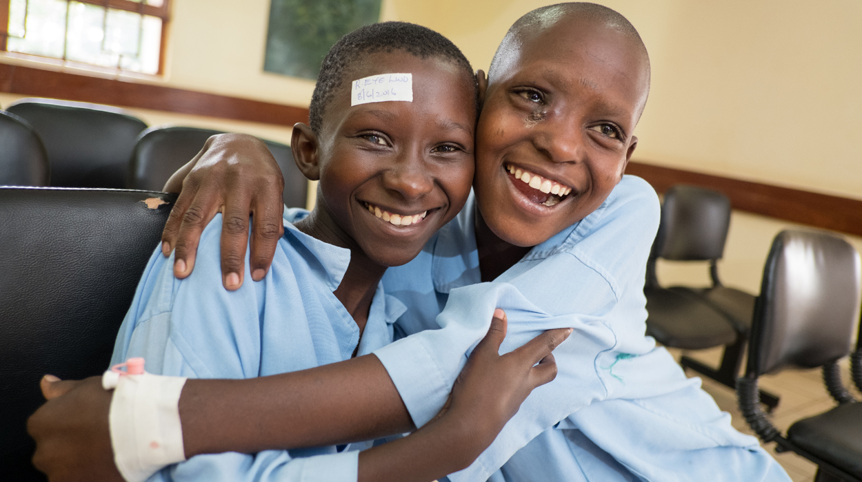 Asia Kiluwa (11) waits with a friend for her cataract surgery at Kilimanjaro Christian Medical Centre in Moshi, Tanzania.