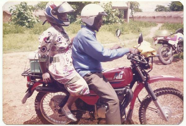 2 opthalmic nurses sitting on a motorbike