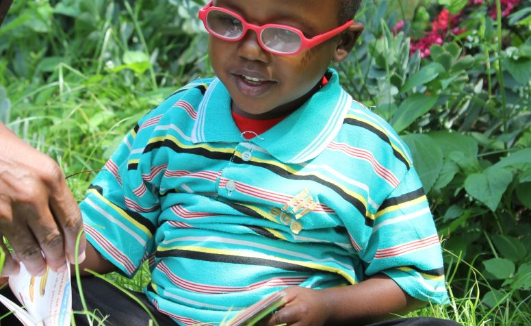 Hemedi Samakafi (3 years old) was operated in both eyes for congenital cataract. Glasses were issued a few days postoperatively. He was able to see pictures in a book, flowers and his father for the first time in his life.