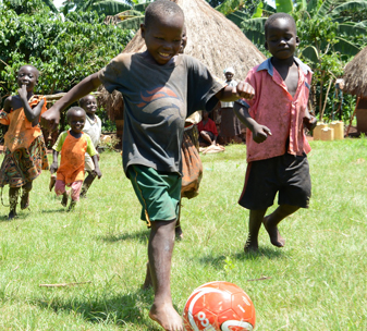 Denis, from Uganda, can now play football with his friends after corrective surgery for clubfoot at CBM's partner hospital.