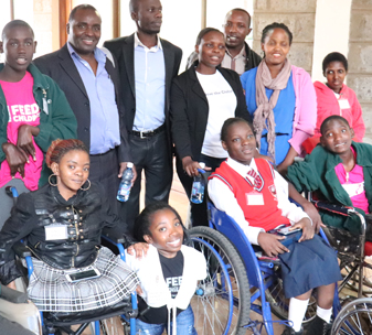 Children with disability pose for a photo with some of the facilitators during the Kenya mini disability summit held on 24th May 2018. The children participated in discussions on disability and gave their recommendations to be considered by the Government of Kenya and other stakeholders. (c) Save the Children International.