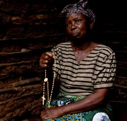 Elizabeth sat in her mud hut holding her rosary beads.