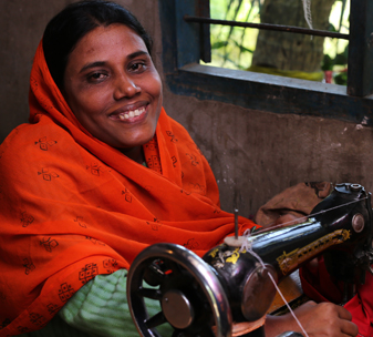 Khaleda from Bangladesh with her sewing machine at home.