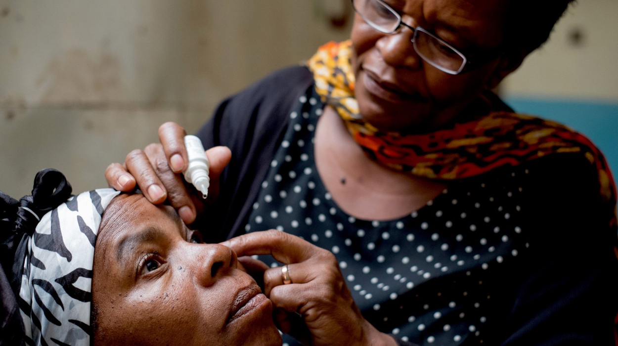 A patient gets a check-up from ophthalmic nurse Valena Matai, coordinator of the diabetic eye-screening department at Kilimanjaro Christian Medical Centre, during a diabetic outreach at Mawenzi hospital in Moshi, Tanzania.