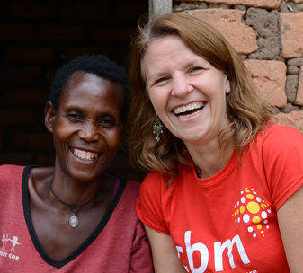 Kirsty and Prisca, outside Prisca's home in the Masaka District, Uganda.
