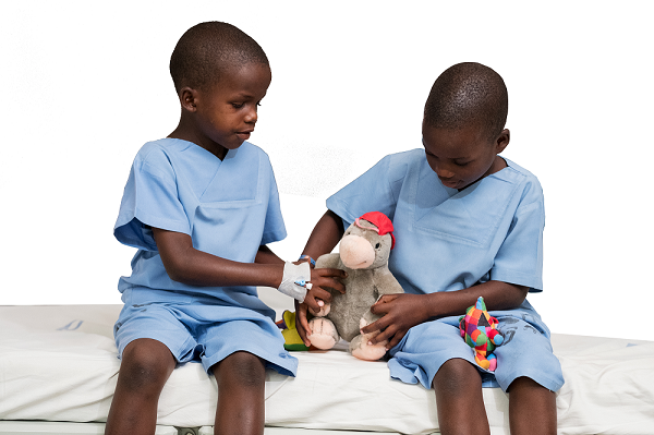 Lucy and Yona playing with a colourful toy after cataract surgery