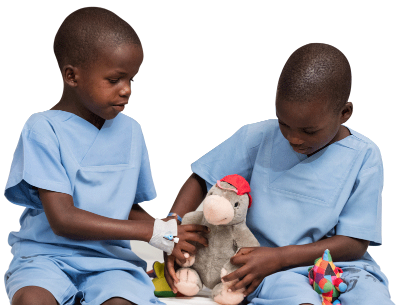 Yona  and Lucy play with stuffed animal toys (including CBM mascot Chris) after having their bandages removed following their cataract surgery