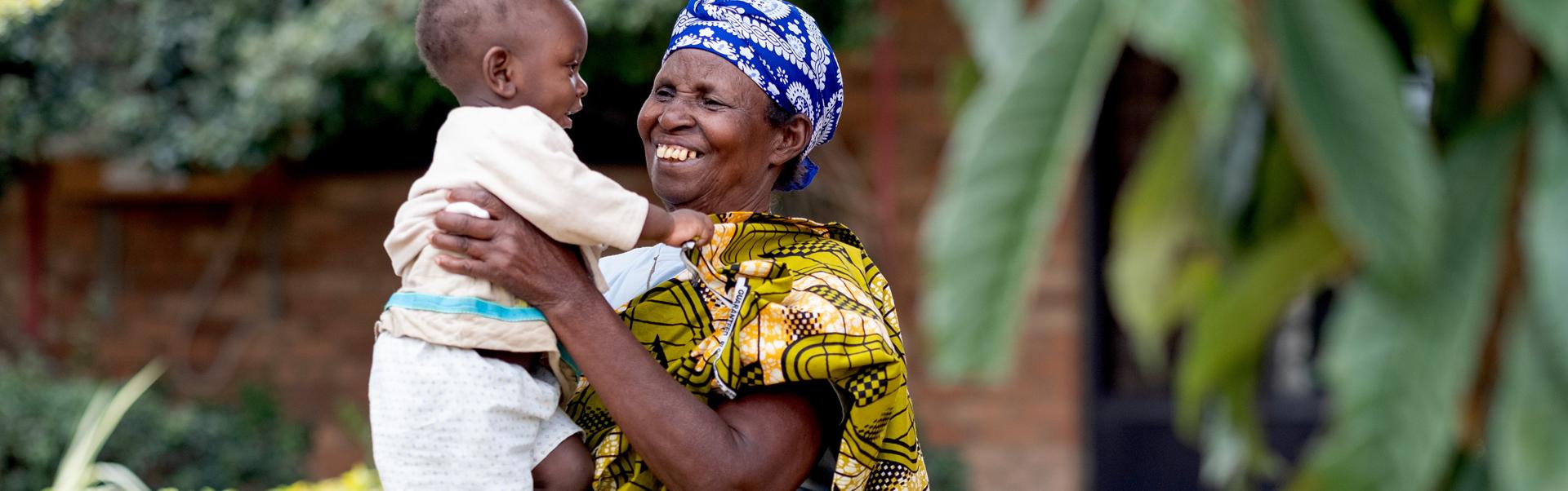 Salome holding her grandson