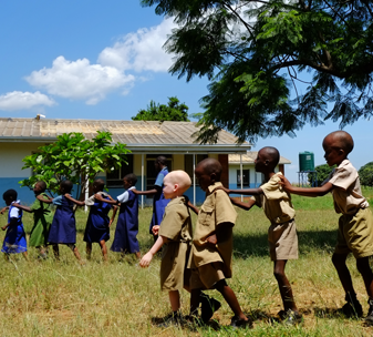 Students lead one another back to class after recess break at the Kadoma School for Children with Visual Impairments in Kadoma, Zimbabwe