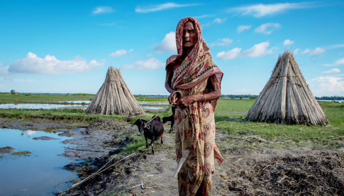 Lady standing outside tents in Bangladesh