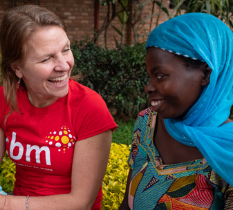 Kirsty meeting Clarisse and her 15-month-old son, Irene, at a CBM-supported outreach centre in rural Rwanda
