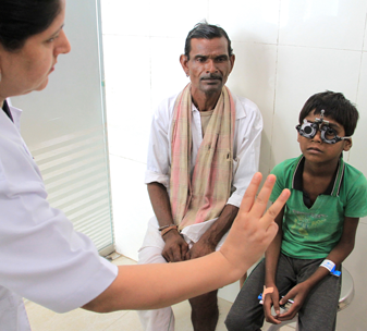 6-year-old Gokul from India having an eye examination after successful cataract surgery