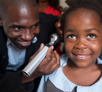 5-year-old Grace being examined by audio technician Patson at CBM's partner Beit Cure Hospital in Zambia ©CBM/Hayduk