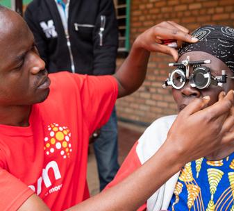 Eye examination at CBM-supported outreach in Rwanda.©CBM/Hayduk