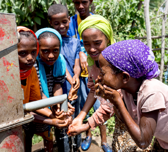 Schoolchildren using a hand dug well, funded by CBM, at a primary school in Ethiopia ©CBM/Diemer