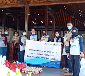 CBM's partner in Indonesia distributing basic needs and hygiene kits, in collaboration with village cadres and leaders in Siraman Village, Gunungkidul, Indonesia.