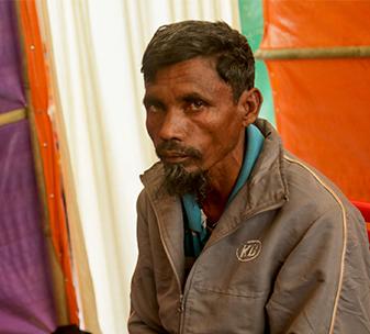 Kamal in makeshift tent at Cox's Bazaar refugee camp in Bangladesh