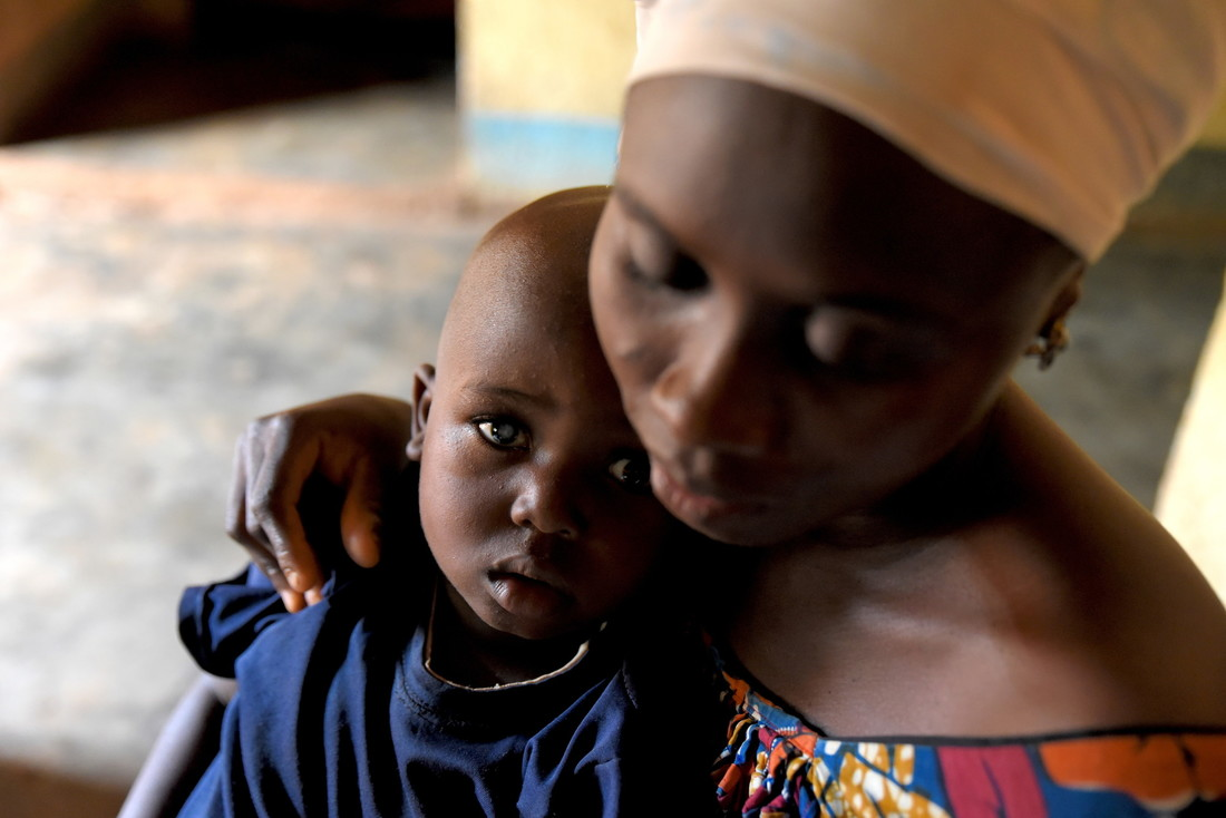 Nahel, 3, with his mum Kaintouna in their home.