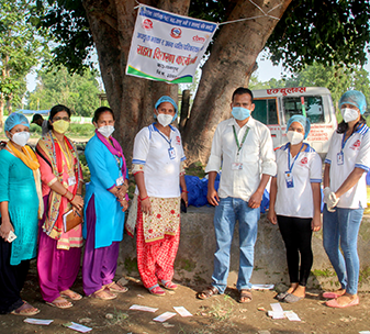 Members of CBM's partner the Nepal Disabled Women Association (NDWA), wearing face masks and preparing to deliver emergency relief packages to people in need.