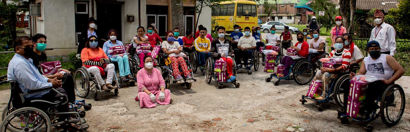 Members of the Nepal Disabled Association in Kathmandu, Nepal, receiving hygiene items (such as bandages, diapers and antiseptics) and medical supplies (such as catheters) from CBM's partner Nepal Disabled Women Association (NDWA), during COVID-19.