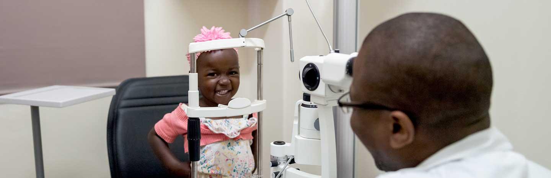 A young girl named Ruvimbo having an eye examination.