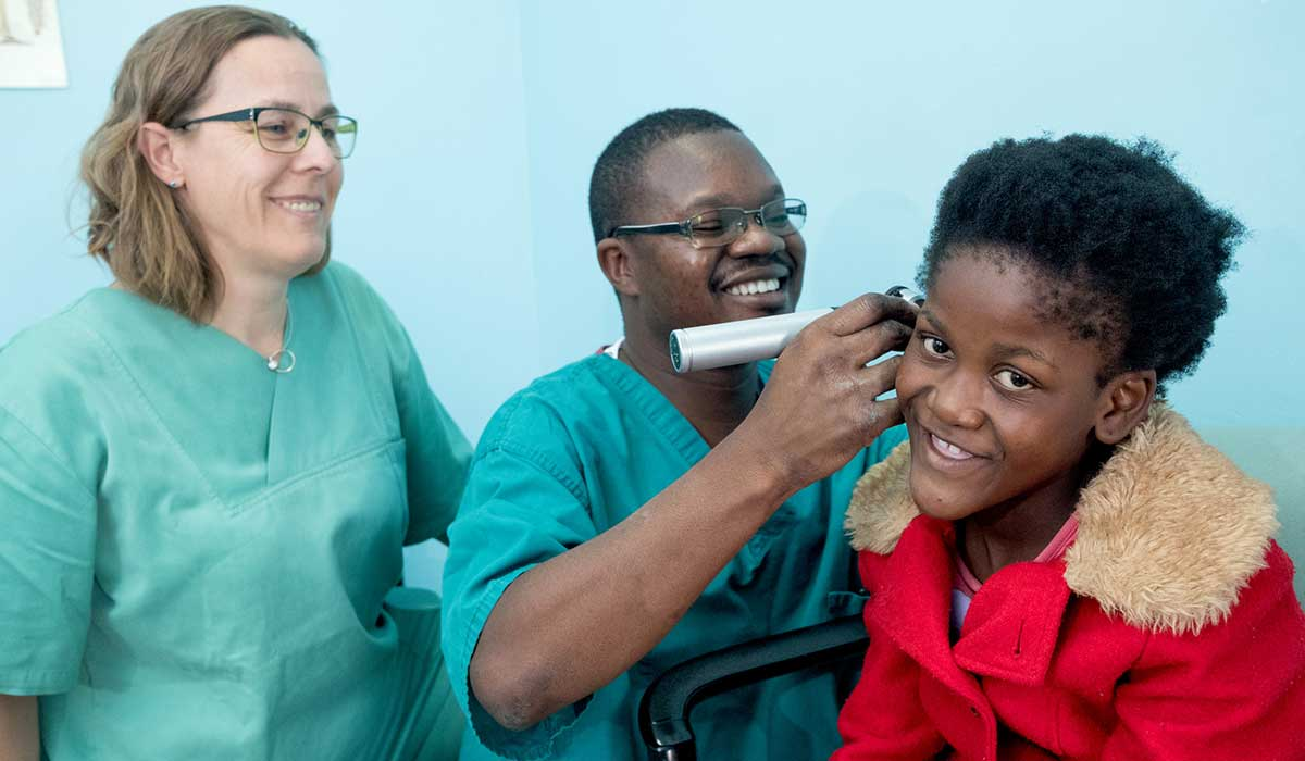 Doctor Harrison Phiri carrying out an ear examination on Anne (11) at Beit Cure Hospital in Zambia