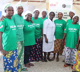 Community champions at the Survive Fistula Healthcare Foundation in Nigeria, wearing t-shirts saying 'Ask Me' to help raise awareness and encourage other women to seek help.