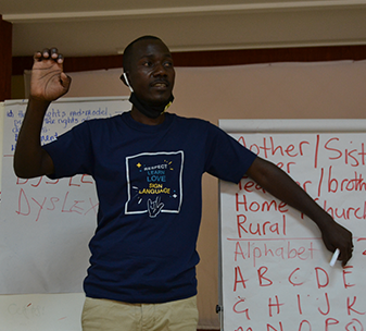 A Sign Language Facilitator demonstrating during a training session.