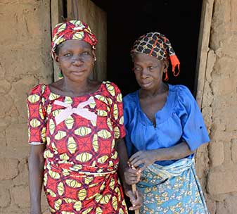 An elderly lady with river blindness, and her daughter, in Nigeria