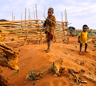 Children in southern Madagascar stand in fields now covered in sand, following sand storms caused by the prolonged drought.