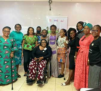 Participants attending a meeting between the disability and women's movements