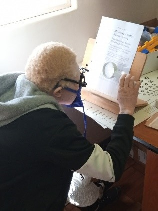 Youth with albinism at Sekuru Kaguvi Hospital, undergoing low vision assessments