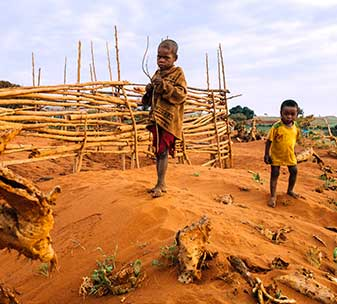 Two young boys standing on sand in Southern Madagascar