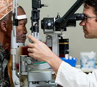 Dr Heiko Philippin carrying out laser treatment on a patient at KCMC hospital in Tanzania