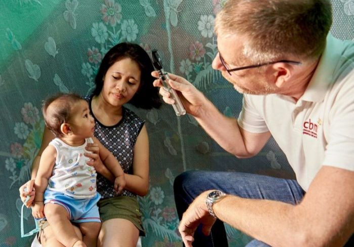 Baby Gabriel from Philippines suffers from ROP and is at risk of going needlessly blind. He is being screened by a doctor.